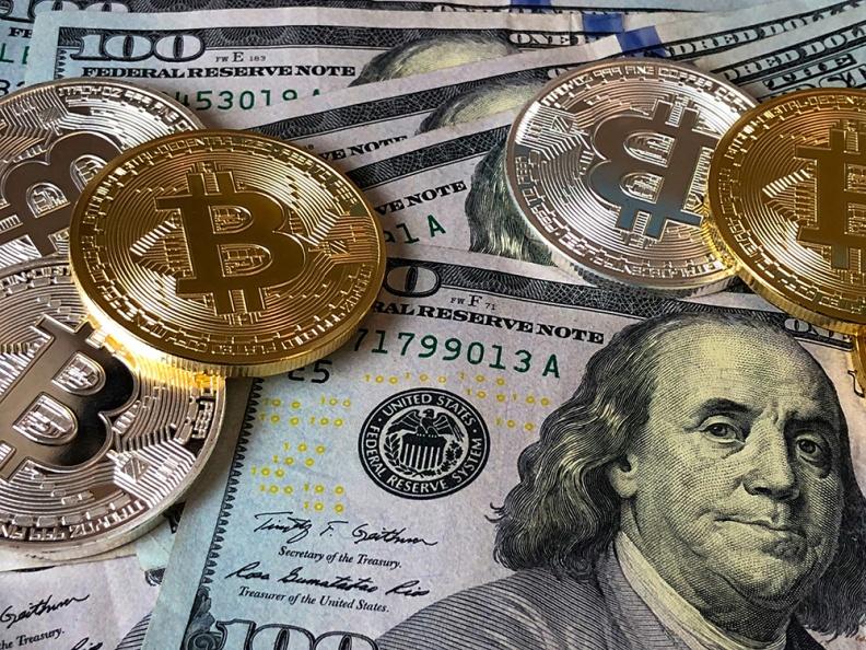 黄金 摩根大通:投资者抛了币,买黄金去了